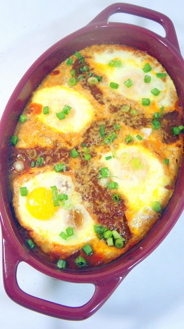 Eggs in Purgatory  Uova al purgatorio    This is soooooo easy, and cheap.  Especially if you make your own Herbed Tomato Sauce for Pasta, Pizza or Cooking!  You are simply poaching the eggs in a tomato sauce, adding great flavor to the simple egg!