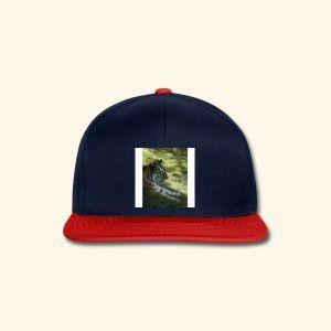Snapback-caps Oldschool-stil, ikke bare for hiphop-kidsa. Den moderne baseballcapsen i retroedesign er selve prikken over i-en for alle med en avslappet funky stil, og for den sportslige og urbane typen.  Rett skjerm og avflatet topp  Størrelsen kan justeres på baksiden  Skjermen er grønn på undersiden  Materiale: 100% akryl