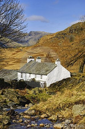 Scenic view of mountainous landscape of Lake District National park with Blea Tarn house in foreground, Cumbria, England.