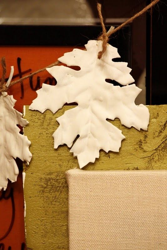 fabric leaves from the dollar store... dipped into plaster of paris. Great idea for garlands, wreaths, table decor, and more...
