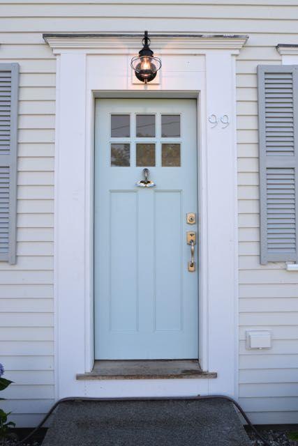 Front Door with Whale Tale Knocker, Benjamin Moore Harbor Haze paint, Baldwin lock set, onion lamp and Jeld-wen door located in Chatham Cape Cod.  #flipitorbust