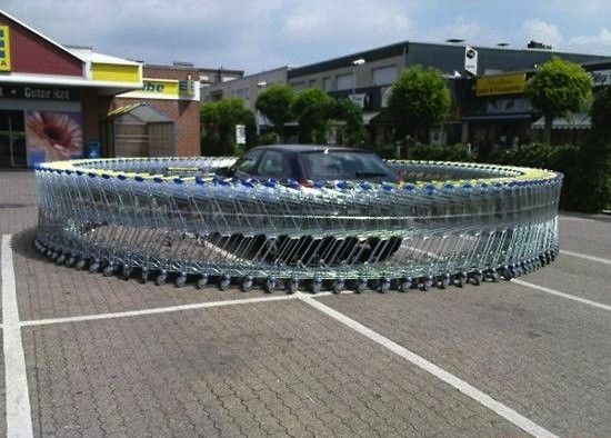 funny photos, car pranks, vehicle pranks, car prank ideas, car surrounded by shopping carts