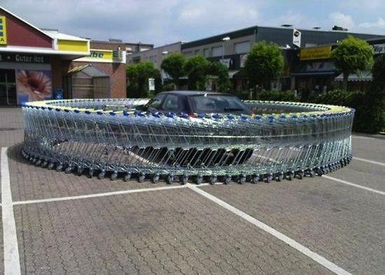 funny photos, car pranks, vehicle pranks, car prank ideas, car surrounded by shopping carts