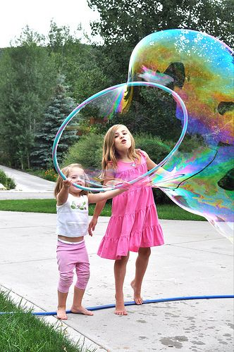 Giant bubbles using a hula hoop! Love this!!  If not for a chunk for sure happening for fun during one of the weeks of camp!