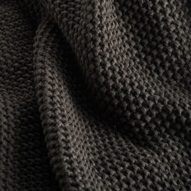 The most versatile piece every home needs! The humble throw rug. Our knitted seedstitch Chelsea throw is a lightweight, warm, washable & cost-effective option. Shown here in Charcoal.