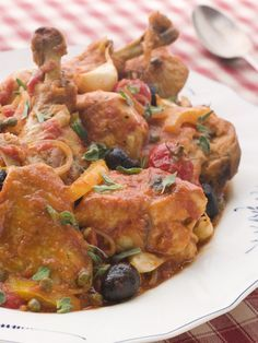Where ever chickens are raised, where ever Mediterranean flavors abound,  you'll find some version of this hearty chicken stew served.  Call it Chicken Provençale in the south of France,  or Chicken Cacciatore in Italy, the basic flavor profile remains the same.    A gently braised chicken infused with olives, capers, tomatoes and freshly snipped herbs is the deal.  And we like to serve it over wide egg noodles.