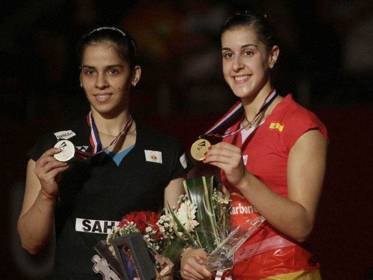 Saina Nehwal & Carolina Marin....Want to learn how you can support your passion for badminton by travelling around the world to watch the best badminton championships ? Click the photo to watch the free video that shows you a tried and tested system that will enable you to make money online from home so you can support your badminton passion   #badmintonchampionship #badminton #badmintonfan