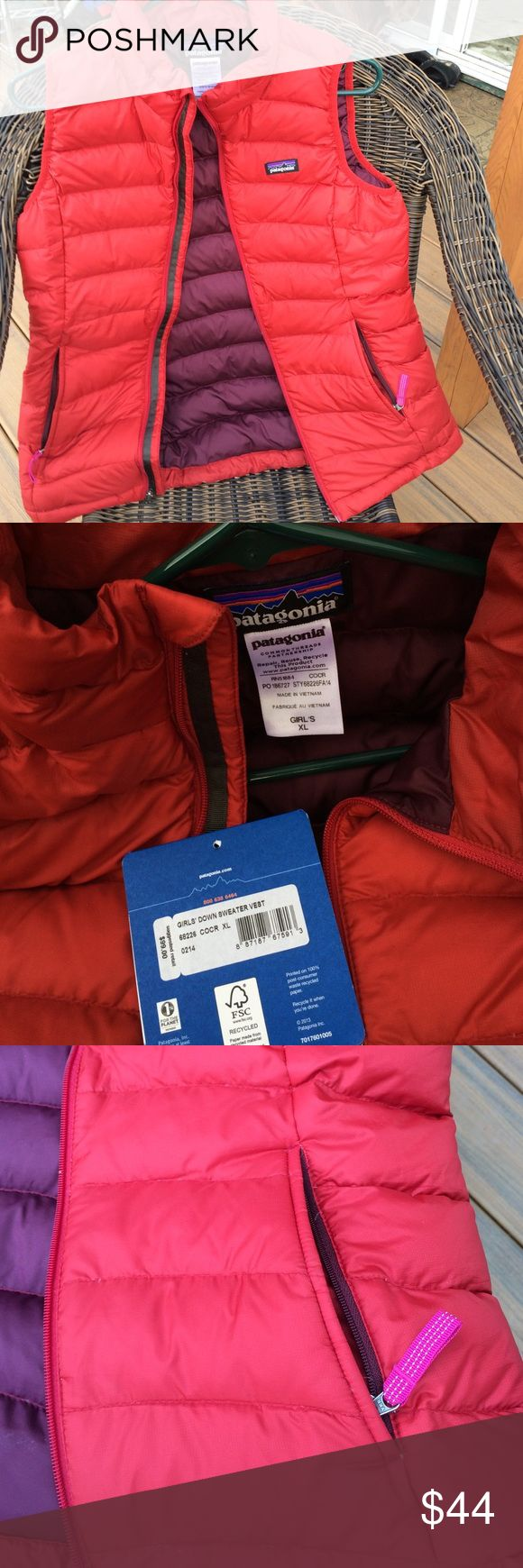 """Patagonia Down Sweater Vest in Red Girls XL Like new w detached tags Patagonia Down Sweater Vest in CorRed (red w brick red in it) Inside is plum. Worn only once. Pockets are fleece lined w pink reflective zipper pulls. Down is 100% traceable to source. Girls XL will fit also a Women XS. Shoulder to hem is 24.5"""", armpit to armpit across chest is 17"""", 19"""" across at bottom hem. Happy Red Patagucci y'all💃💋 Patagonia Jackets & Coats Vests"""
