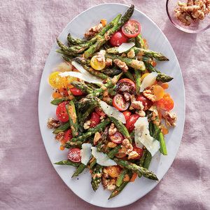 Roasted Asparagus with Walnuts, Parmesan, and Cherry Tomatoes | MyRecipes.com