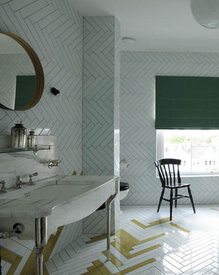 """The irregular placement of pigmented herringbone tiles creates a """"coloring book"""" effect in this bathroom from Studio Too Good Designs."""