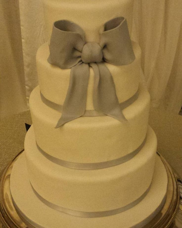 4 tier wedding cake in white and grey