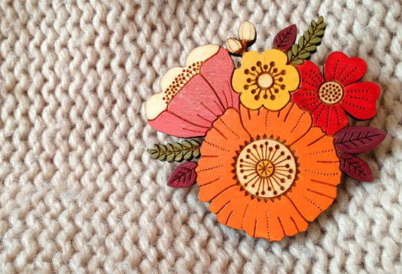 Part of my In Bloom collection. This pretty posy brooch has been laser cut in 3mm birch wood and delicately hand painted in beautiful Autumn colours.