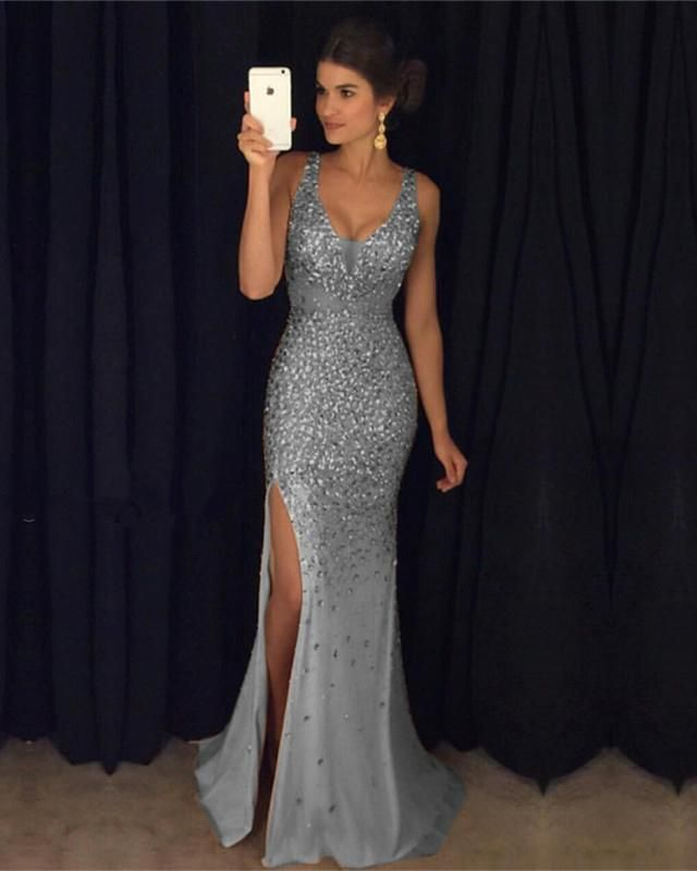 Item Description   A Glamorous Form Fitting crystal Mermaid Dress Featuring  a v-neckline with spaghetti straps and Leg slit c63dfd91f2f5