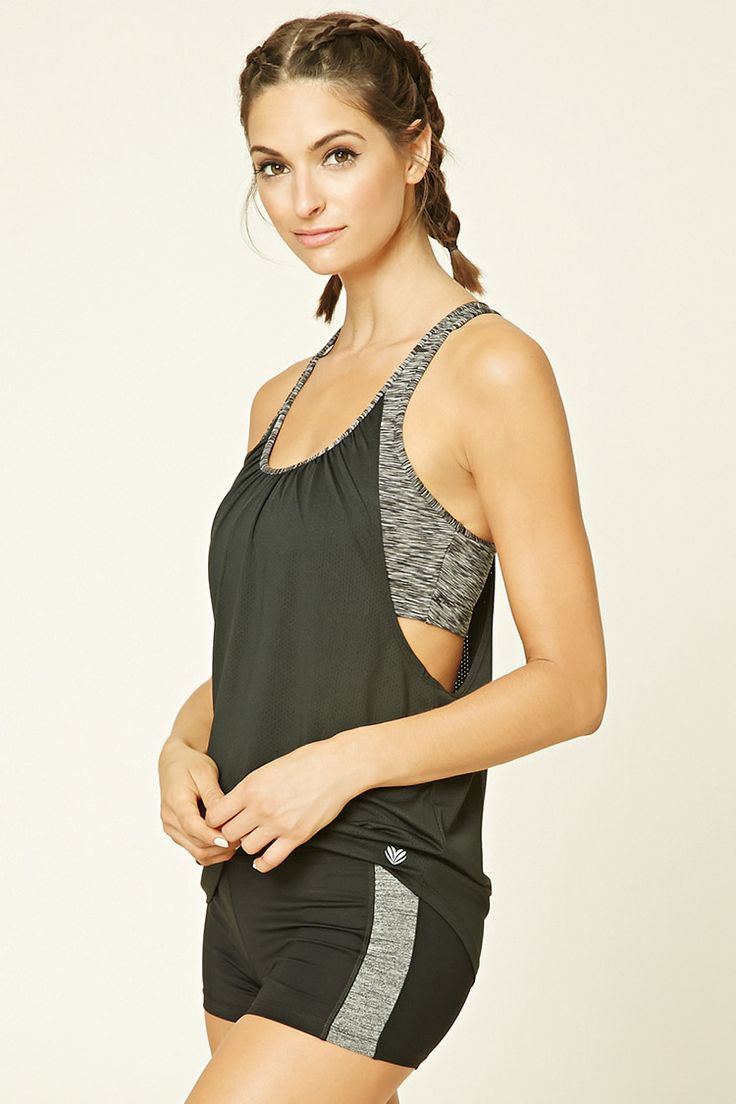 A mesh knit racerback tank top featuring a rushed detail at the back, dropped armholes, a round marled neckline, an attached marled knit sports bra, and moisture management.