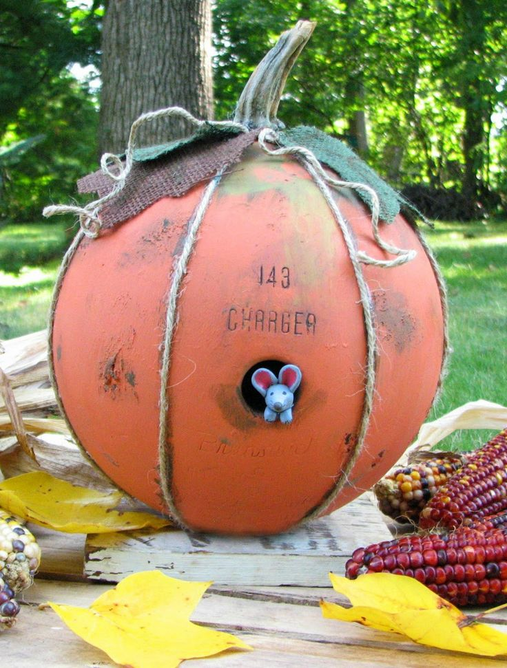 Get your hands on an old bowling ball and make your own mouse hidehole for a charming effect. Bonus: We bet nobody will try to steal your pumpkin once they feel how heavy it is.  Get the tutorial at Prodigal Pieces.    - Redbook.com