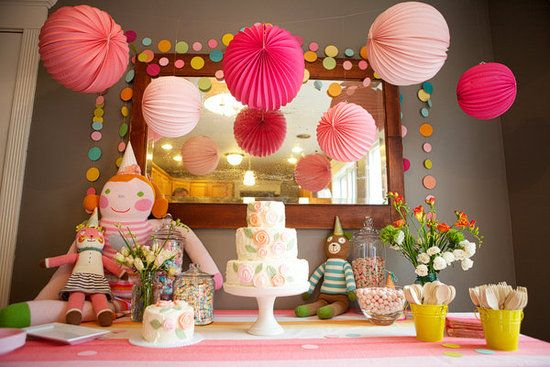 Dessert Table: A friend of Margot's mom made the matching cakes (one for the guests, one for the birthday girl). The cakes were displayed with paper lanterns, Blabla dolls, and various pastel candies, which guests took home as a party favor.  Source: Portraits by Lucinda