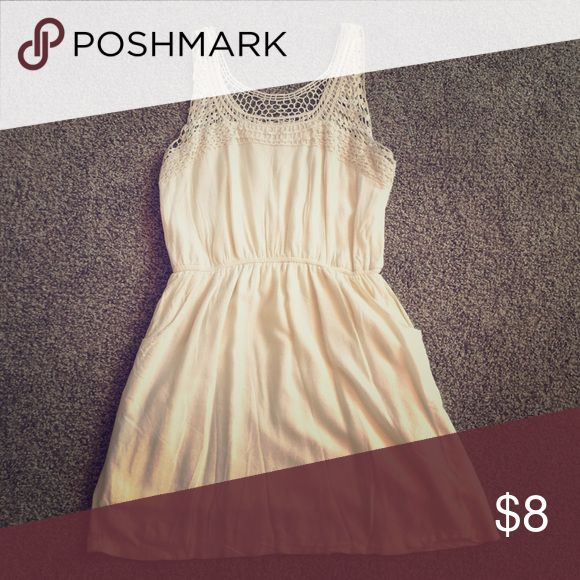 Cream Summer Dress w/ Pockets! Cream colored summer dress with crochet accent top. It has pockets! Charlotte Russe Dresses Mini