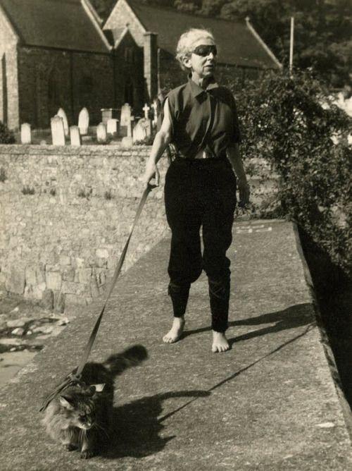 Claude Cahun walking her cat, 1949