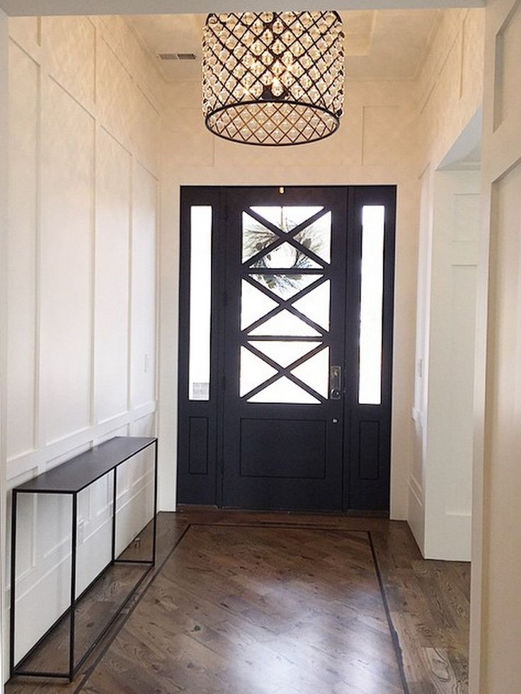 Gorgeous front hall/door/light fixture.  Love the Black and White.