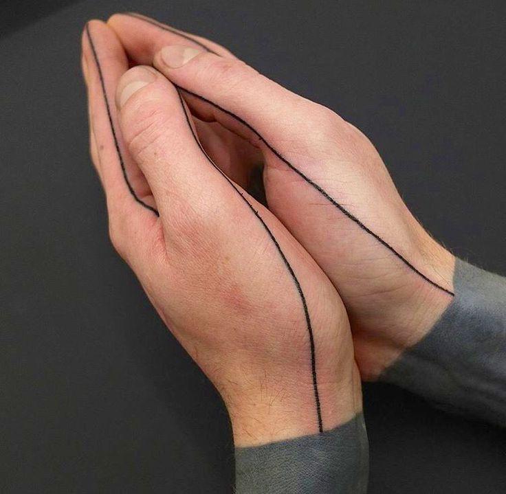 Geometric line tattoo around the hands. I love tattoos like these, so odd and understated  #line #hand #tattoo