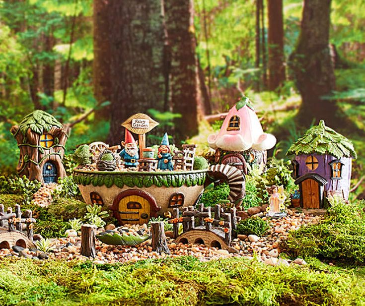 I found a enchanted teacup fairy garden collection at big lots for less find more garden decor for Big lots garden decor