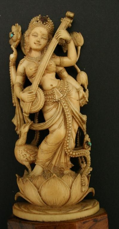 Carved ivory statue of goddess Saraswathi ... look at the expression on her face