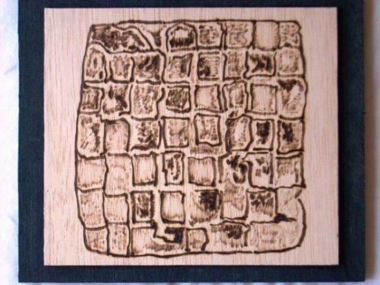 Pirograbada sobre madera natural de 3 mm., montada sobre contrachapado de 6 mm. pintado de negro. Medidas 20 x 17 cm.