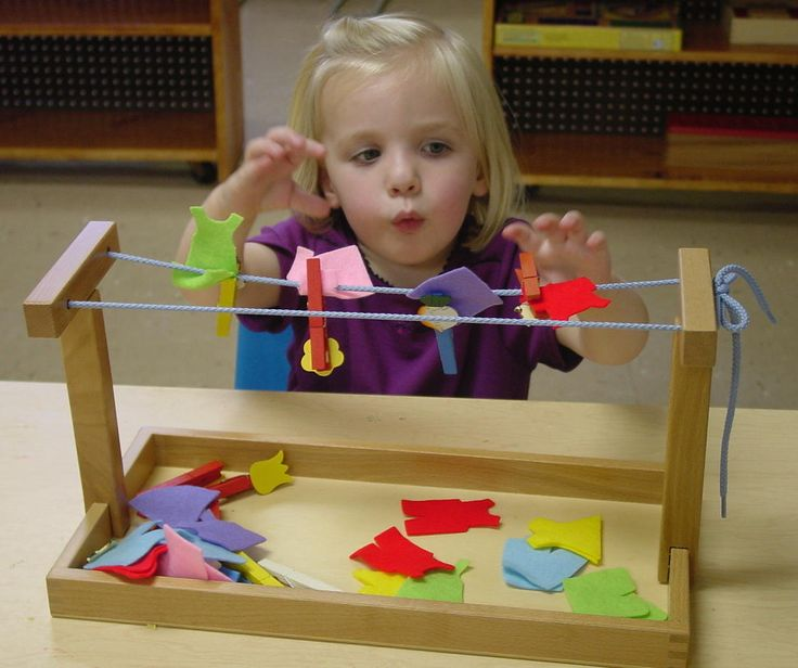 Motor-- Tiny clothes line with felt clothes, and typical sized clothes pins. Montessori
