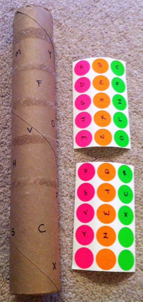 Letter Recognition activity. The labels we used didn't stick!  It was a mess, and frustrating for the kids!  They had fun using the cardboard tube as a horn, though.