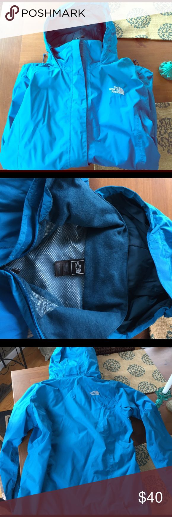 Bright blue North Face rain jacket ☔️ In good used condition fully lined rain coat. One small stain near zipper but no rips or tears. Fleeced lined collar and two front pocket zippers. Elastic on sides to adjust fit. Women's large North Face Jackets & Coats Trench Coats