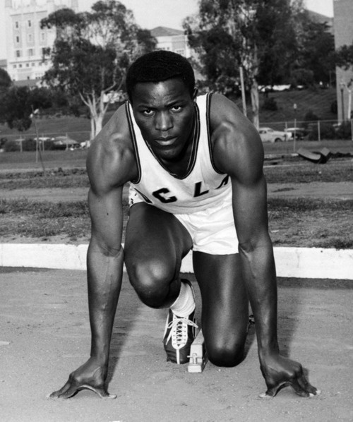 """Rafer Johnson, 1957 UCLA all-around track and field star, 6'3"""", 200 pounds, 21 years old, junior, and one-year varsity letterman, whose hometown is Kingsburg, Calif. The world record-holder in the decathlon. Placed second in the 1956 Olympic Games decathlon. Placed second in both the broad jump and high hurdles in the 1956 NCAA meet."""