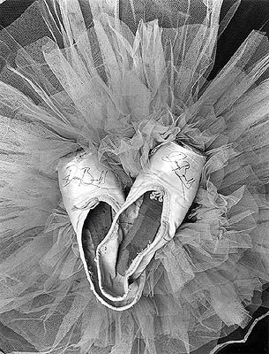 Worn in point shoes and a tutu