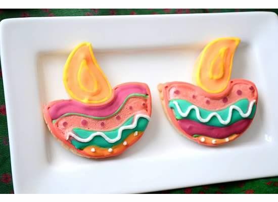 Diwali cookies in the shape of diyas and rangoli. #Diwali #recipe #Indian #sweet #cookies #Diya #rangoli