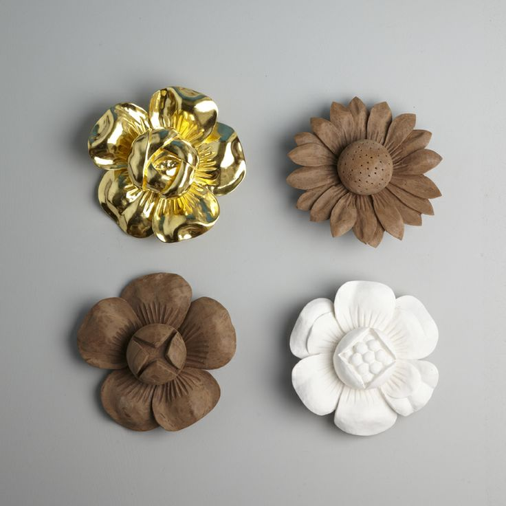Carved flowers. 16 cm diameter. Carved wood roses, daisies, peonies and clematis which can be left with a raw wood finish, a white gesso finish or gilded in any colour of gold or palladium leaf.