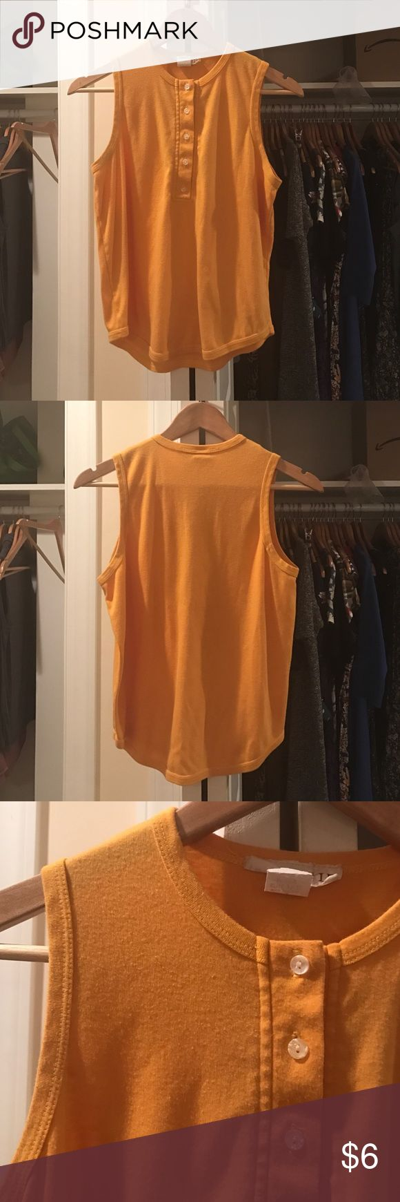 Vintage marigold yellow tank Super cute marigold yellow tank top with buttons halfway down the front. Great color with normal wear for its age, awesome with a high wasted skirt to look like a lil ray of sunshine Tops Tank Tops