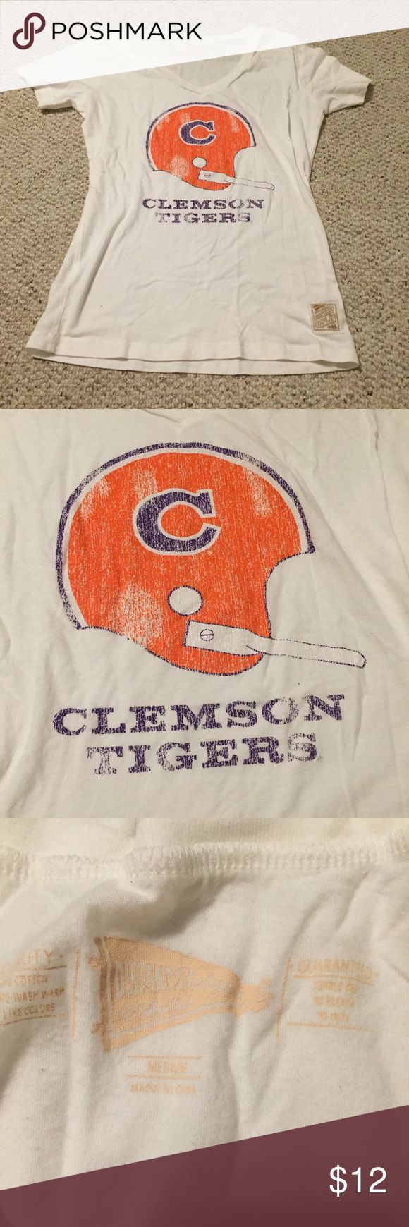 Clemson football white v neck tshirt Vintage looking tshirt with the clemson football helmet. Great for game day! Don't think it has ever been worn. Is a fitted medium or a looser small clemson Tops Tees - Short Sleeve