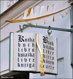 "Knihkupectví / Book Store ""U Stríbrného groše"" - Kutná Hora (Central Bohemia) - Unique Artistic Shop Signs on Waymarking.com"