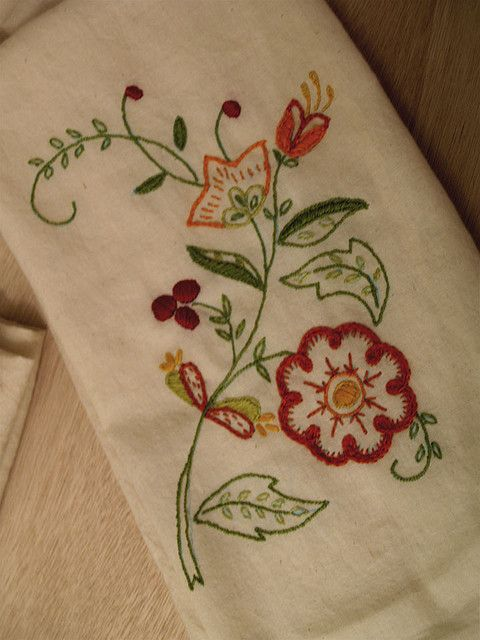 floral embroidery on pillow cases, dish cloths, dresser scarves.