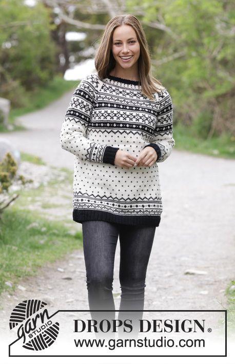 Strikket genser med flerfarget mønster og raglan. Størrelse S - XXXL. Arbeidet er strikket i DROPS Karisma