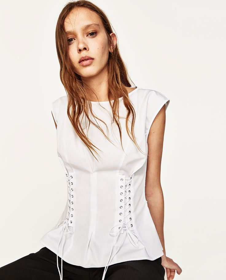 Corset style top to emphasize the waist. Feminine and boho.