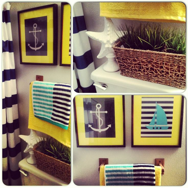 Nautical bathroom on a budget: Shower Curtains & Towels - Target.com Planter - Ikea.com Fake Grass - Michaels.com Wall Art - Help from the Goodwill & Photos from google.com blown up at Walgreens.com