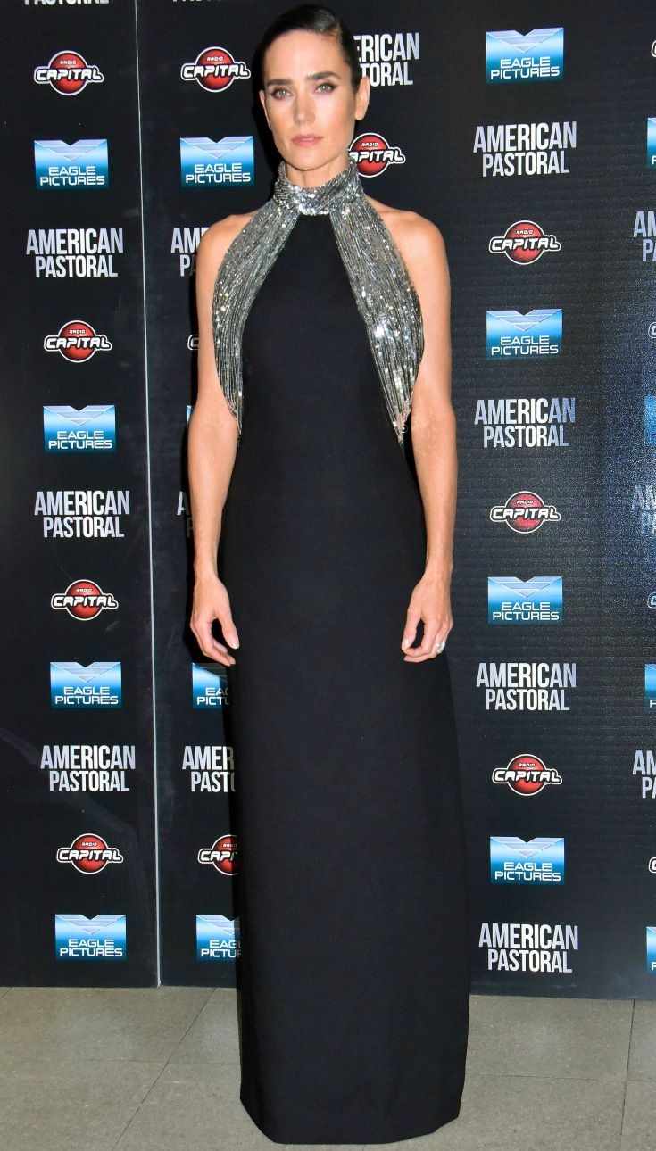 JENNIFER CONNELLY in a black mock-neck Louis Vuitton gown with bright silver beading at the American Pastoral premiere in Rome.
