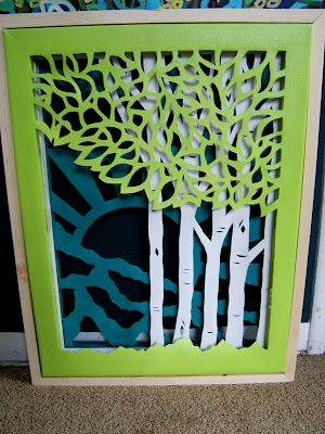 Awesome Wall Art- Made by cutting up 3 canvases and layering them!