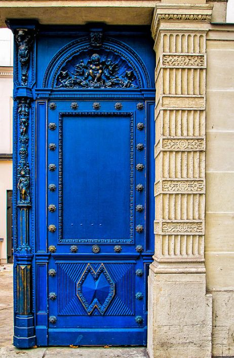 This bright blue door creates a wonderful focal point