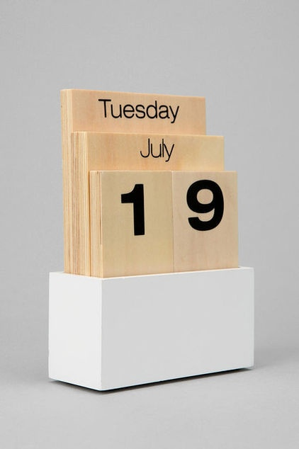 Simply switch out the wood panels to change the date with this interactive wooden desktop perpetual calendar.