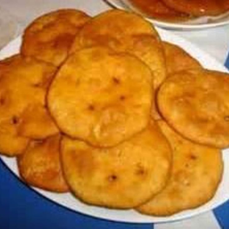 Raised in Arizona,I was brought up with this recipe and have made it for over forty years. It is a standard recipe for fry bread,and have always made it smaller for kids to handle easier. It is a bread used as a staple on all reservations, used mostly with lamb or beef piled on..DELICIOUS!  Food Triva: Which N/A tribe puts a hole in the middle of the fry bread for turning?