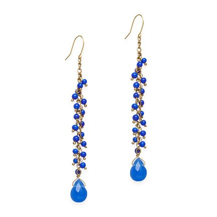 Multi drop blue earrings are fabulously chic. Lapis colored tourmaline stones adorn a single strand down the center of these earrings, ensuring just the right amount of dangle with every turn of the head. Found it on the bohemian trunk