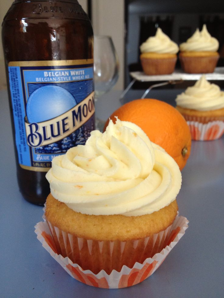 Blue Moon Cupcakes and Orange Frosting - make frosting orange and use my color sprayer to lightly spray some blue on them