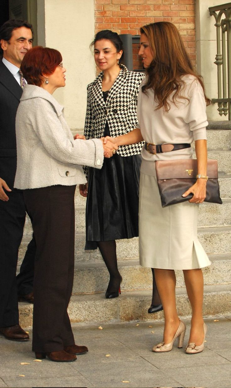 Queen Rania of Jordan. Love the Prada clutch!