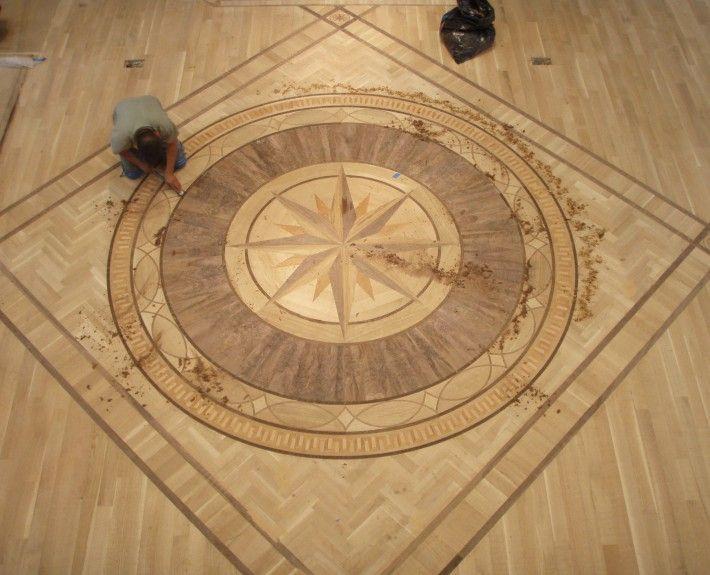 Harwood floor medallions wood floor medallions for Hardwood flooring distributors